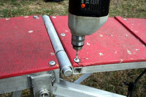 Drilling the head off a rivet.