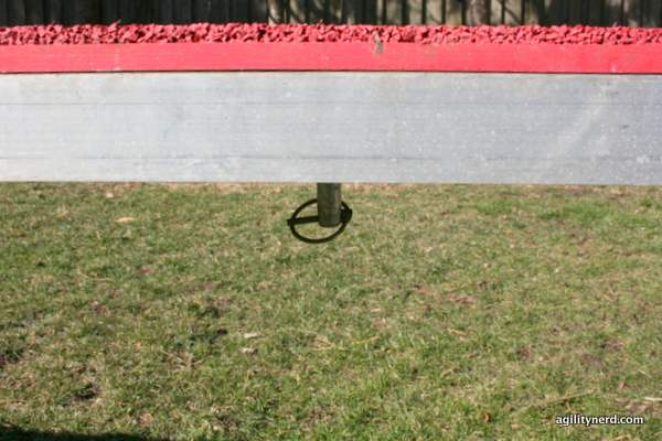 Dangerous pin/clip under lowered dog walk