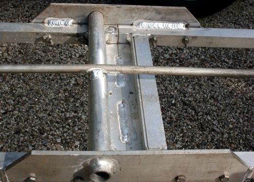 Photo of rod and internal side welds on teeter