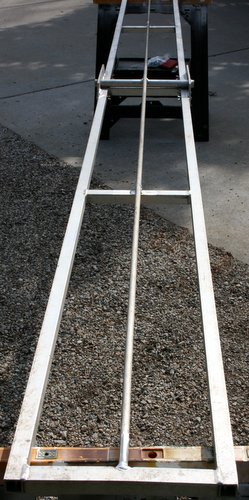 Photo of full length stiffening rod on underside of teeter